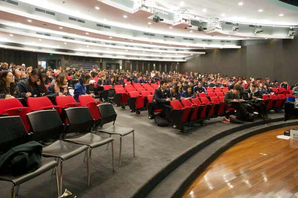 The crowd of students listen to the presentations in the short problem solving competition